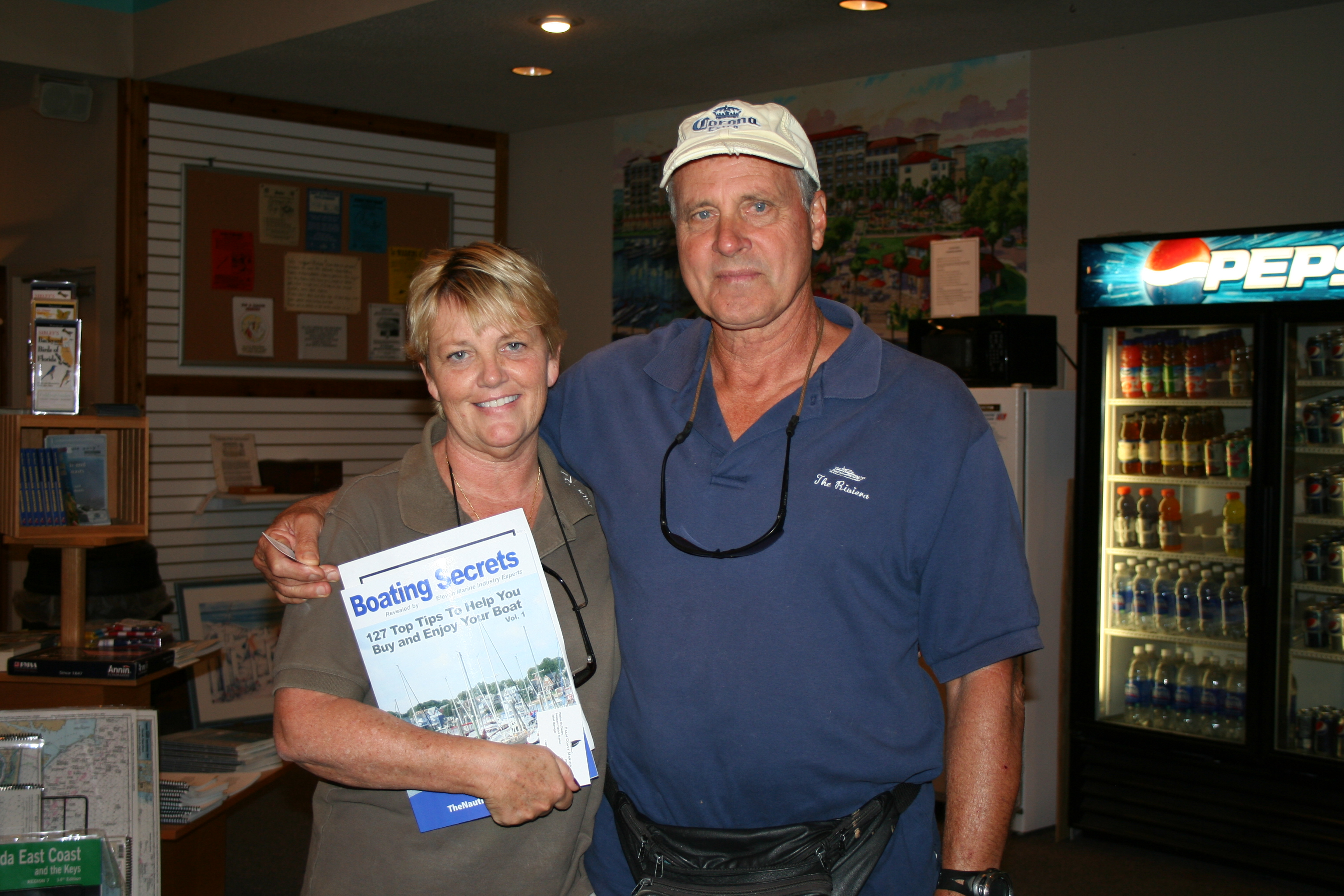 Roe McCauley of Palm Coast Marina, FL with book Boating Secrets: 127 Top Tips to Help You Buy and/or Enjoy Your Boat