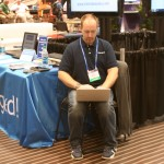 Josh Childs Tweeting in the Social Media Lounge at IBEX