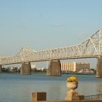 Cyclist and Bridge crossing Ohio River in Louisville