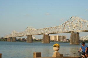 Cyclist and Bridge crossing Ohio River in Louisville